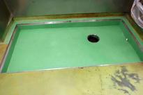 写真:洗浄室排水溝塗床